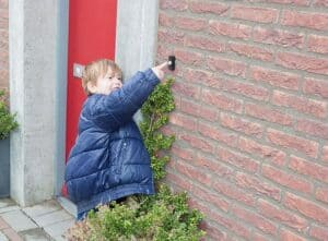 young boy ringing,the doorbell